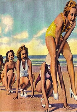 1950s style vintage postcard with girls in bathing suites and sandals playing on beach